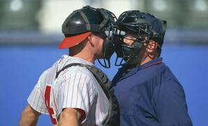 Baseball Catcher and Umpire Arguing